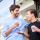 Male Gay Couple On Date Coming Out Of Coffee Shop Together - PhotoDune Item for Sale