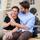 Loving Male Gay Couple Sitting Outside Coffee Shop Hugging - PhotoDune Item for Sale