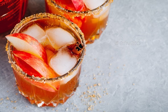 Cinnamon Apple Cider Mimosa cocktail for Halloween or Thanksgiving in glass - Stock Photo - Images