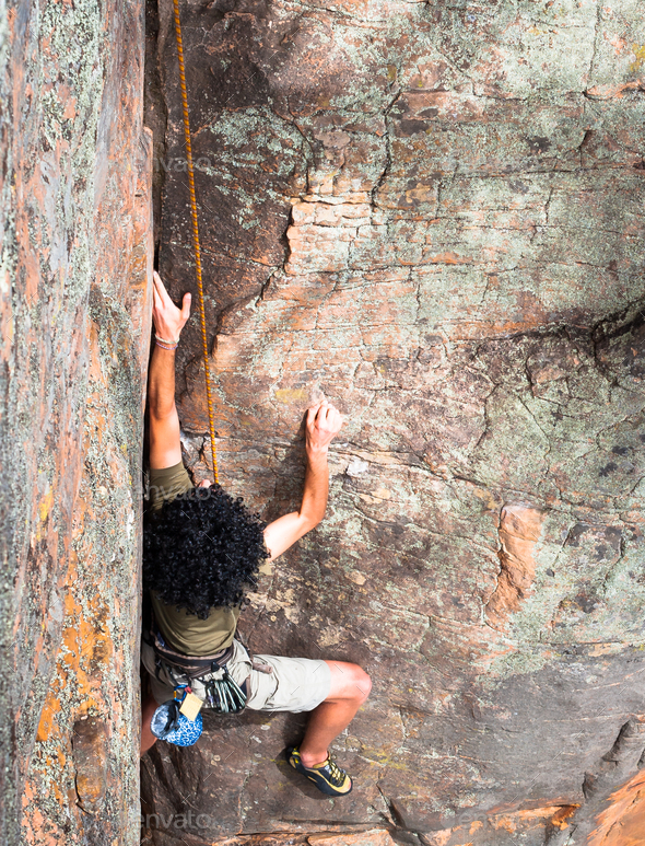 Rock Climber with Large Afro - Stock Photo - Images
