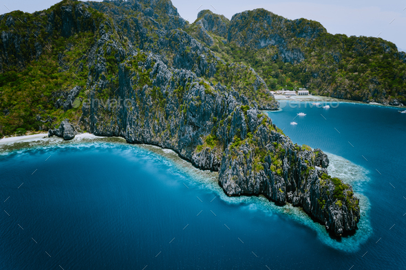 Miniloc Island with limestone cliffs. Aerial drone panoramic picture. Bacuit Archipelago, El Nido - Stock Photo - Images