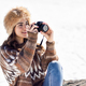 Young woman taking photographs in the snowy mountains - PhotoDune Item for Sale