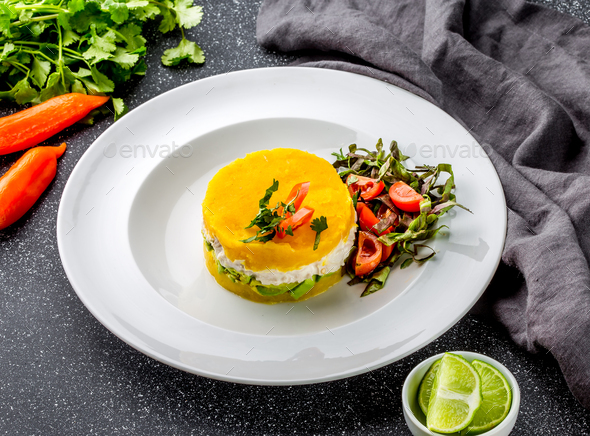 Traditional peruvian dish CAUSA from yellow potato, chicken, avocado on white plate. - Stock Photo - Images