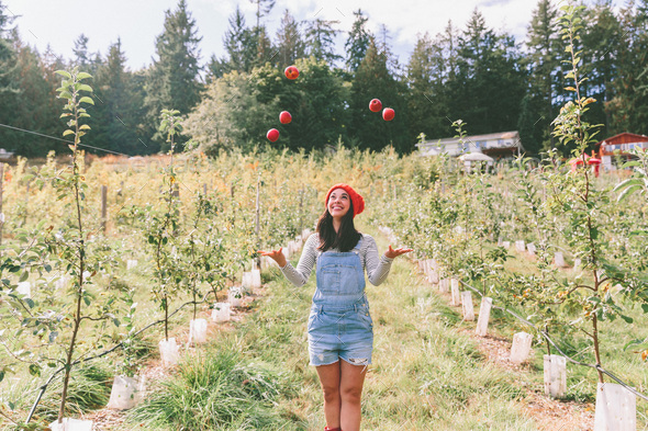 Young Woman in the Apple Orchard - Stock Photo - Images