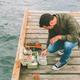 Man Preparing to go Fishing - PhotoDune Item for Sale