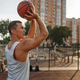 Basketball player makes a throw on outdoor court - PhotoDune Item for Sale