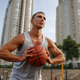 Basketball player aiming for throw, outdoor court - PhotoDune Item for Sale