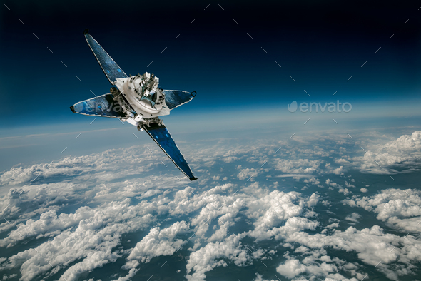 Space satellite over the planet earth - Stock Photo - Images