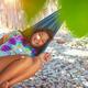 Little girl resting in hammock - PhotoDune Item for Sale