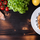 Top view of grilled salmon in a white plate over a wooden background - PhotoDune Item for Sale