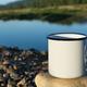 White campfire enamel mug mockup with blue river - PhotoDune Item for Sale
