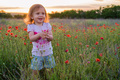 Cute happy child girl in poppy field. Happy childhood concept - PhotoDune Item for Sale