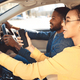 Afro couple driving car and using gps navigator - PhotoDune Item for Sale