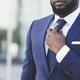 Unrecognizable Afro Man Adjusting Necktie Standing Outdoor In City - PhotoDune Item for Sale