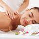 Young woman enjoying back massage in spa salon - PhotoDune Item for Sale