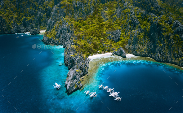 El Nido, Palawan, Philippines. Aerial view of Miniloc Island with diving boats above coral reef - Stock Photo - Images