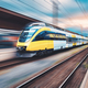 High speed yellow train in motion on the railway station - PhotoDune Item for Sale