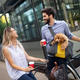 Romantic couple is having rest in the city with dog and bicycles - PhotoDune Item for Sale