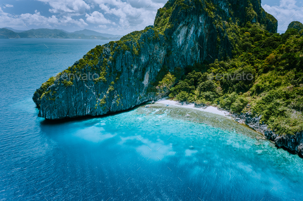 Aerial drone view of tropical Entalula Island. Huge steep rocks cliffs mountains surrounding blue - Stock Photo - Images