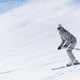 Female Skier Skiing Down the Slope - PhotoDune Item for Sale
