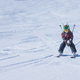Young Skier Skiing Down the Slope - PhotoDune Item for Sale