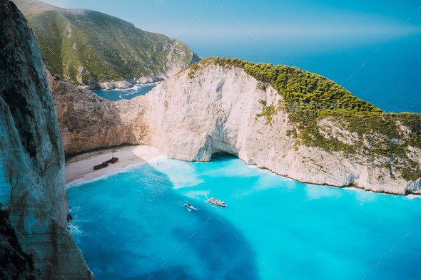 Navagio beach, Zakynthos island, Greece. Two tourist boats leaving Shipwreck bay with turquoise - Stock Photo - Images