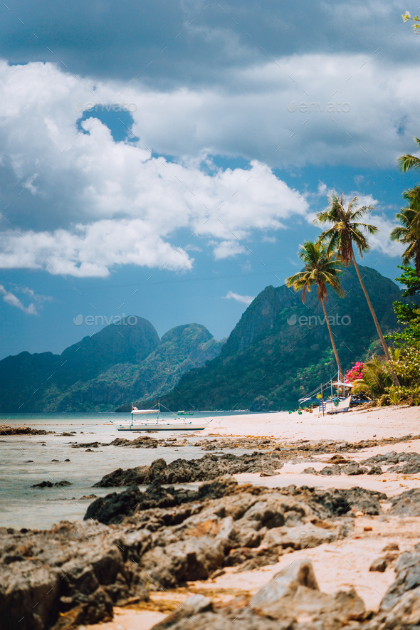 Las Cabanas Beach Palm Trees Mountain And Cloudscape In El Nido Palawan Island Philippines