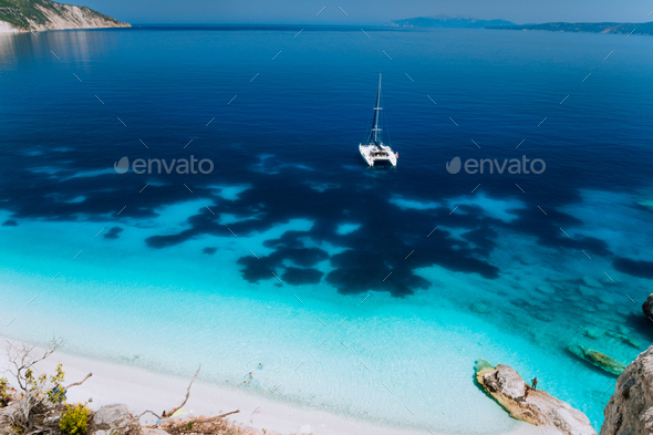 White catamaran yacht drift on clear azure water surface in calm blue lagoon with transparent water - Stock Photo - Images