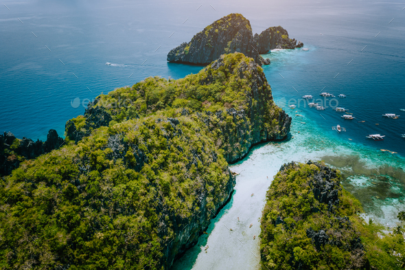Aerial drone view of entrance to shallow tropical Big and Small Lagoon explored inside by tourist on - Stock Photo - Images