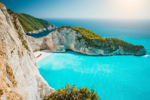 Navagio beach or Shipwreck bay panoramic. Turquoise sea water and white beach between huge cliffs - Stock Photo - Images