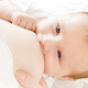 Young woman breastfeeding her little baby boy closeup - PhotoDune Item for Sale