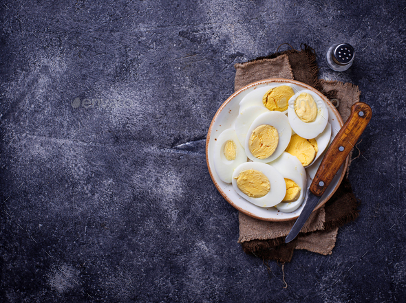Boiled sliced chicken eggs on plate - Stock Photo - Images