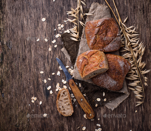 Fresh homemade buns on rustic background - Stock Photo - Images