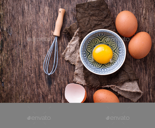 Raw chicken eggs and whisk - Stock Photo - Images