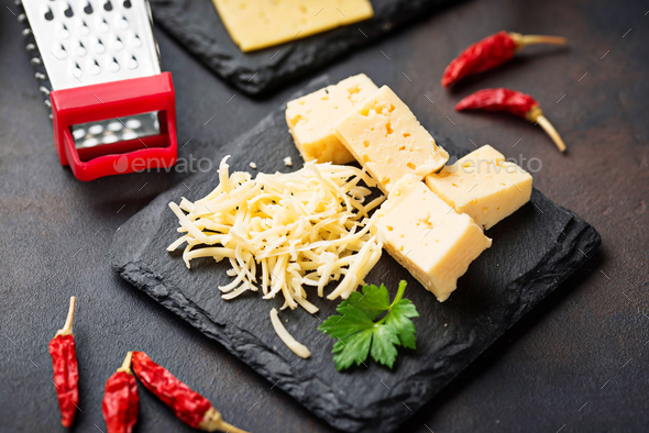 Grated cheese on slate board - Stock Photo - Images