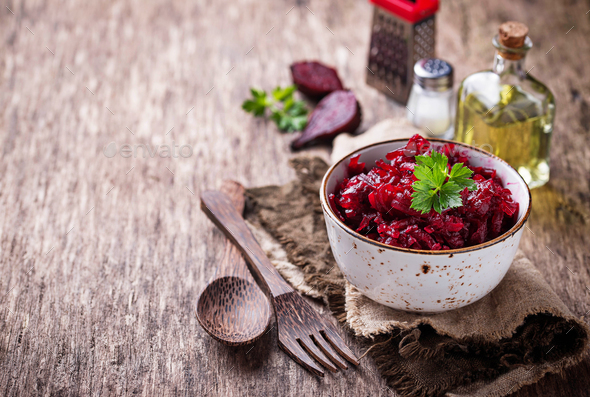 Bowl of beetroot salad on wooden background - Stock Photo - Images