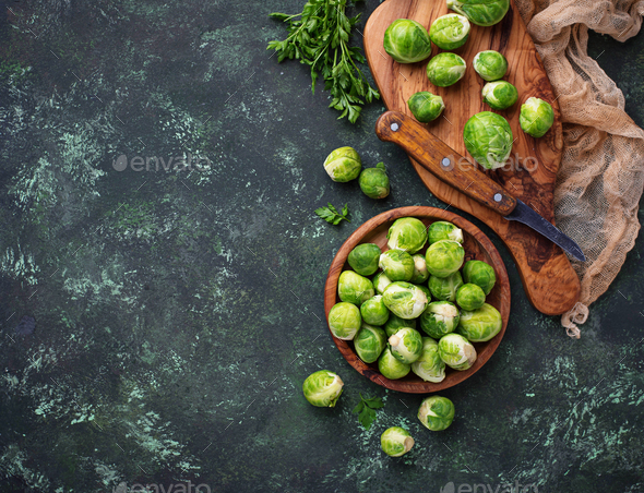 Brussels sprouts on green concrete background - Stock Photo - Images