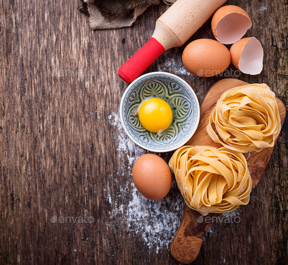 Raw pasta tagliatelle and eggs - Stock Photo - Images
