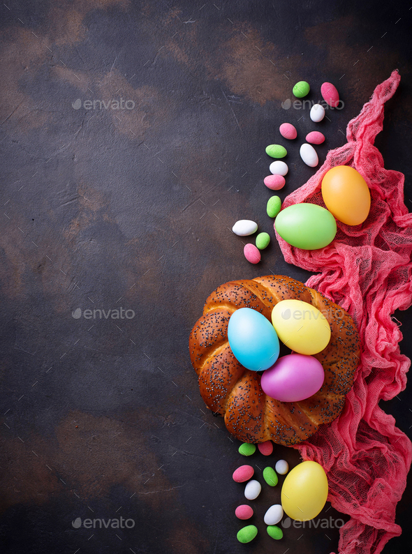 Colorful Easter eggs and wicker bread - Stock Photo - Images