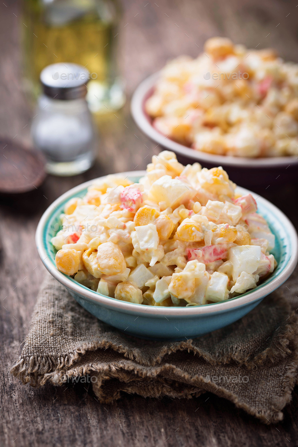 Salad with crab sticks, rice and corn - Stock Photo - Images