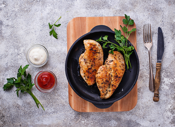Grilled chicken breast or fillet on iron pan - Stock Photo - Images