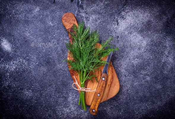 Fresh dill on cutting board - Stock Photo - Images