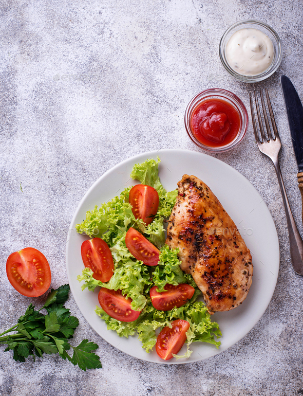 Grilled chicken breast with vegetable salad - Stock Photo - Images