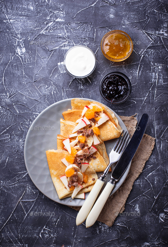 Pancakes crepes with different fruits and chocolate - Stock Photo - Images