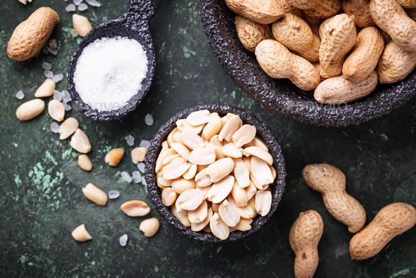 Raw peeled peanuts on bowl - Stock Photo - Images