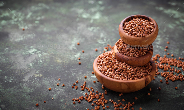 Buckwheat groats in wooden bowl - Stock Photo - Images