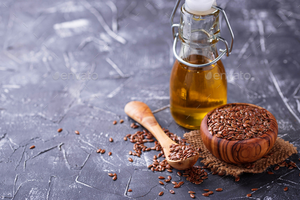 Linseed oil and flax seeds - Stock Photo - Images