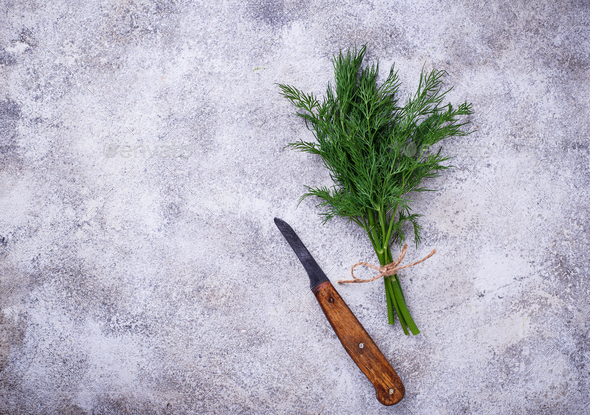 Bunch of fresh dill and knife - Stock Photo - Images