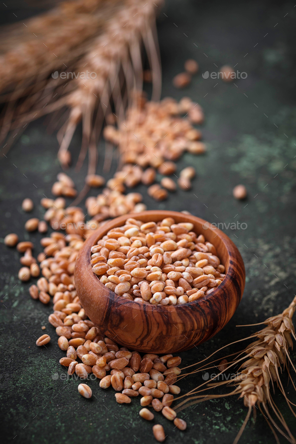 Wheat grains and spikelets on rusty background. - Stock Photo - Images