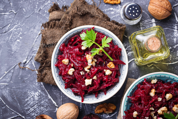 Healthy vegan beetroot salad with walnuts - Stock Photo - Images